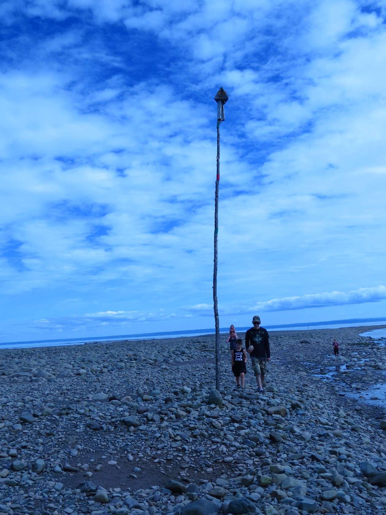 Posing by the tidal pole at low tide, Alma
