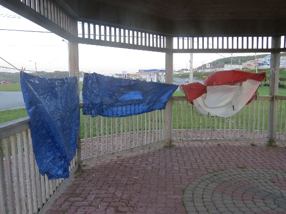 Tent drying on plastic rope in gazebo, Port Aux Basques, NFL
