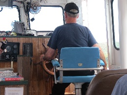 Donelda's husband at the wheel. Donelda's Puffin Tours, NS