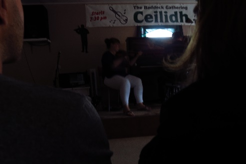Playing in the dark at the Ceilidh kitchen party, Baddeck, NS