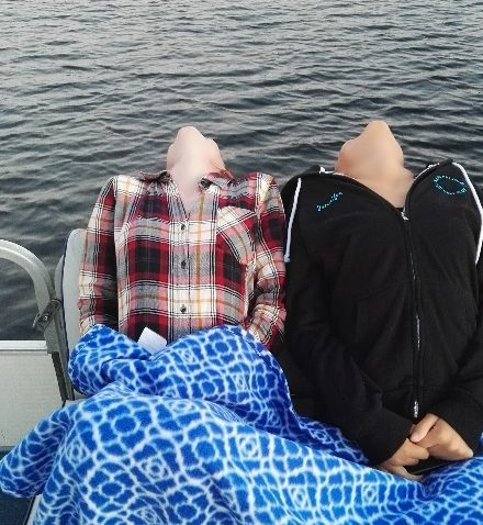 Leaning over the edge of the pontoon, Kennebunk Lake, ME