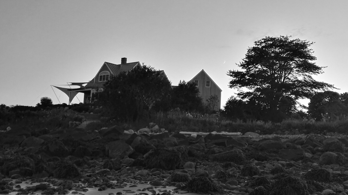 Dilapidated house by ocean, Maine