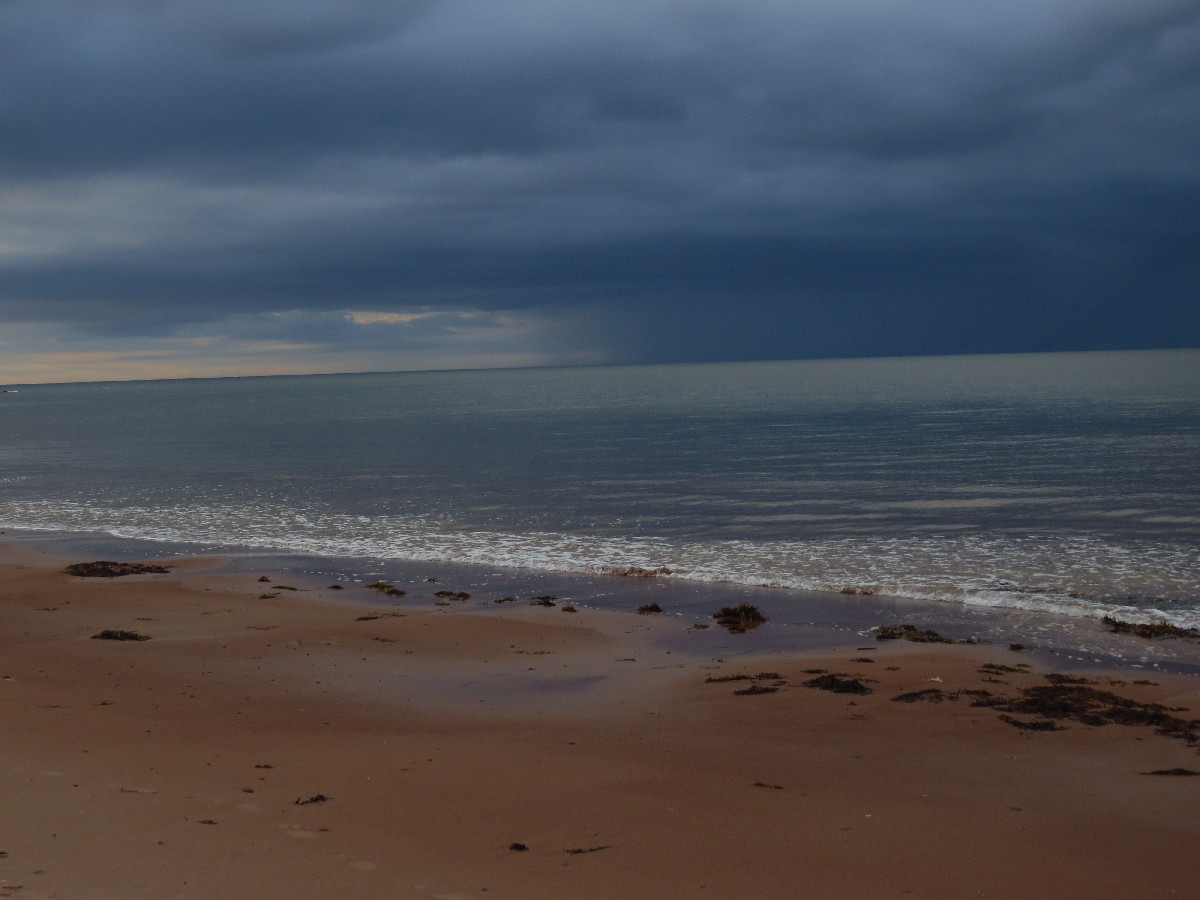 Storm clouds looming over PEI beach, Campbell's Cove, PEI