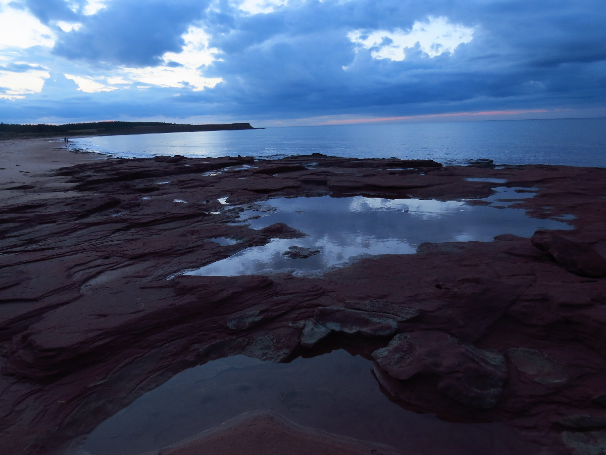 Sky, ocean and tide pools as night sets , Campbell's Cove, PEI