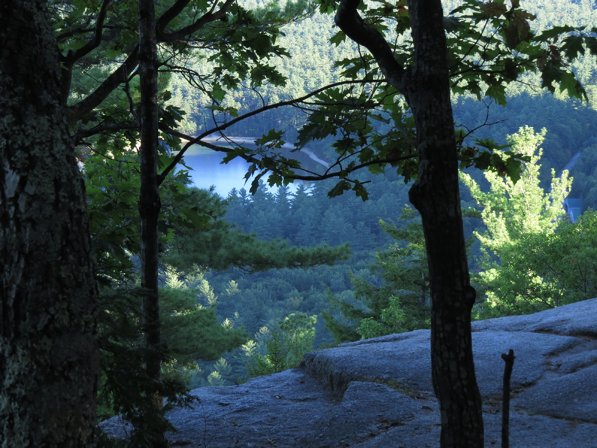 Echo Lake , viewed through trees and cliffs of Cathedral Ledge, White Mountains