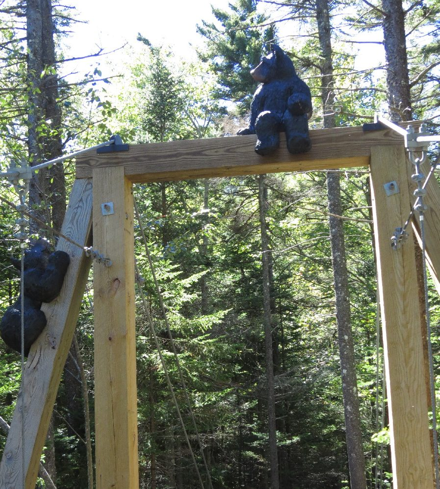 Recreational walk. Bear sculptures on gate. Lost RIver Gorge and Caves . NH