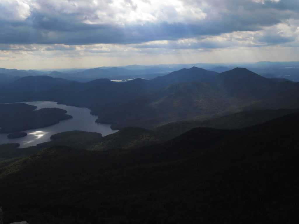 Sun behind clouds. View from Mount Whiteface over Lake Placid