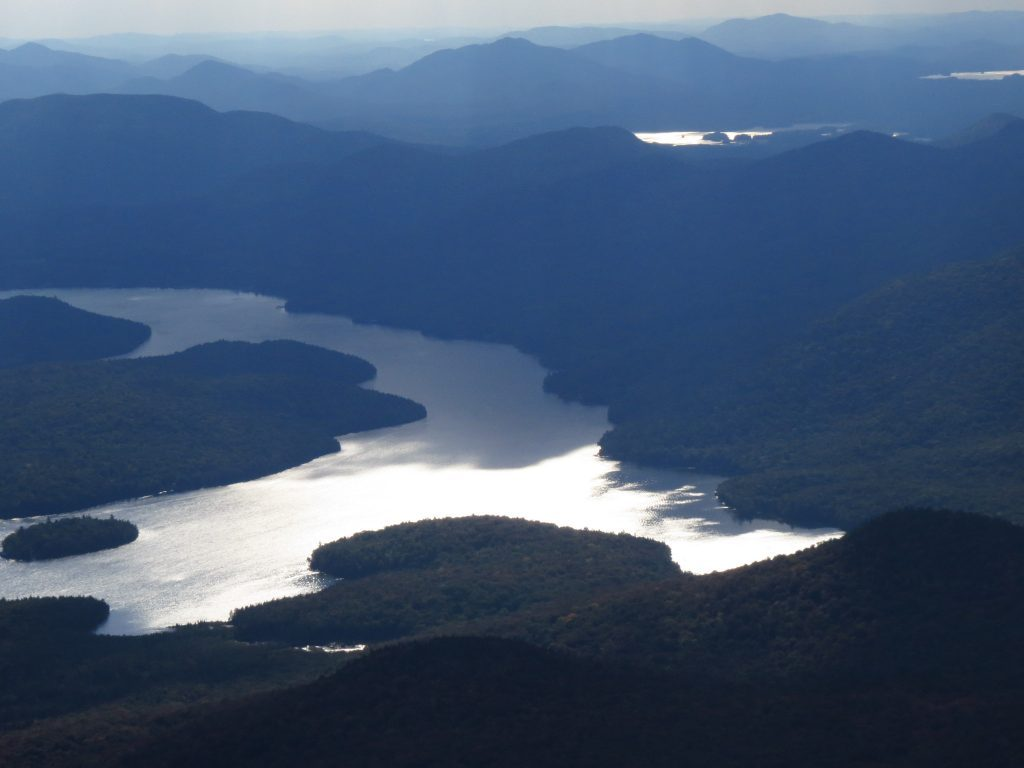 Lake Placid reflecting sun and clouds, view from Mount. Whiteface summit, NYS