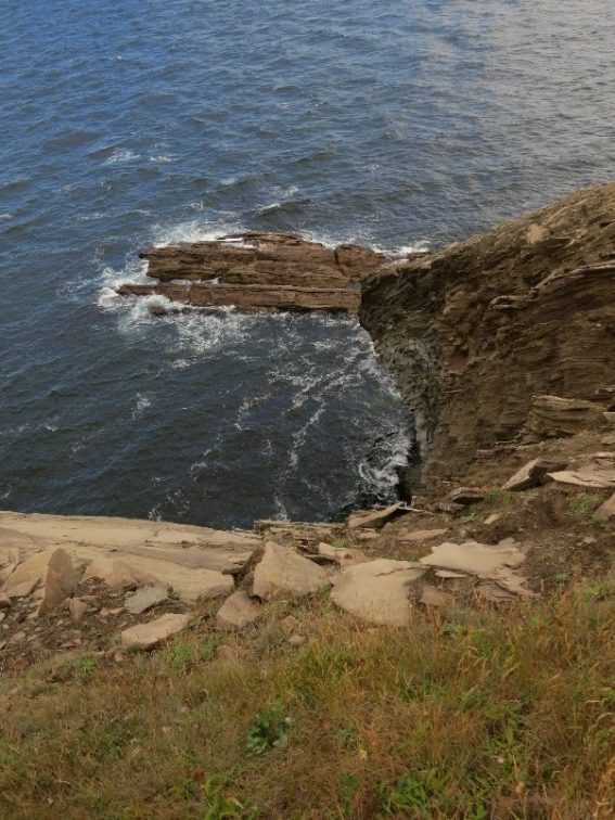 Rock jetty into sea. Meat Cove, Cape Breton