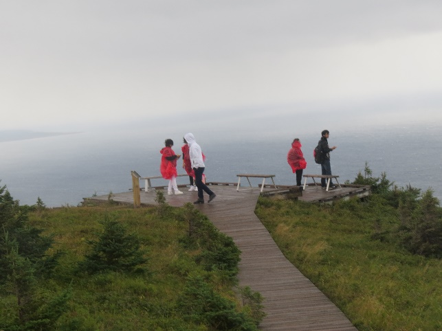 Tourists in wind and rain, Skyline Trail, Western Cabot Trail, NS