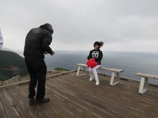 Chinese tourist takes picture of wife in weather, Skyline Trail, Cape Breton, NS