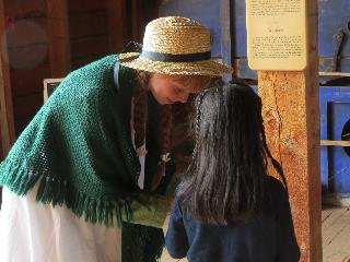 Anne of Green Gables helping girl in Cavendish museum, PEI