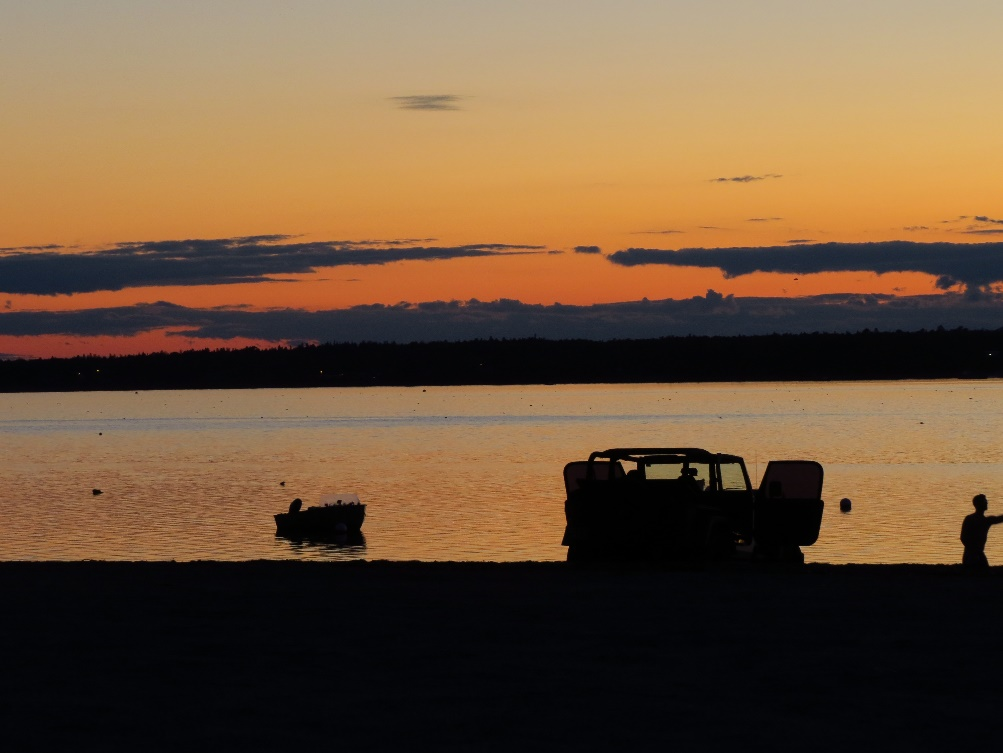 Car and boat sillouette against twilit sky, Mount Desert Island