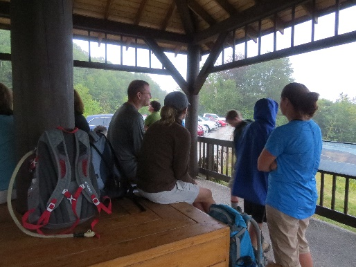 Scouts and families in rain shelter, Kancamagus Road, NH