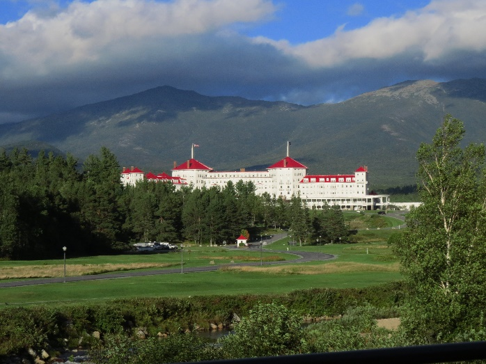 Castle-like hotel seen from scenic drive vista, White Mountains, NH