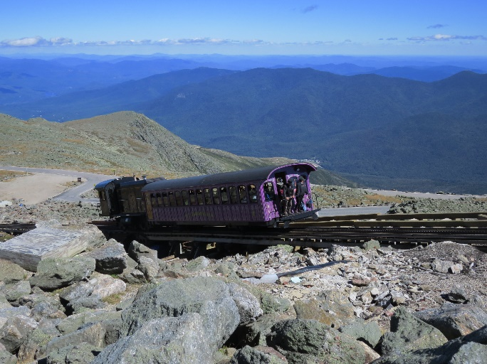Cute, but expensive, cog trail chugs up to summit, Mt. washington, NH
