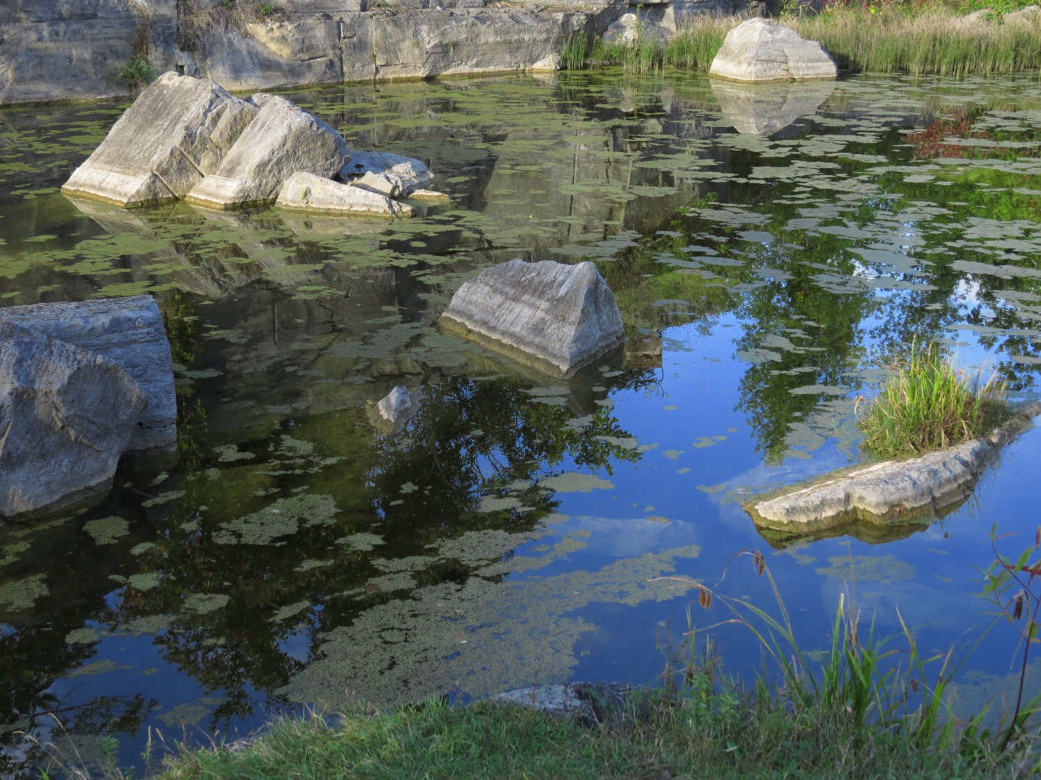 Rock, sky and water in a Fisk Quarry Pond, La Motte