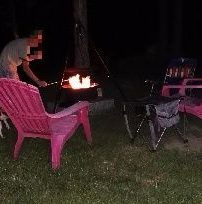 Preparing S'mores over fire, Lazy Lions Campground, VT