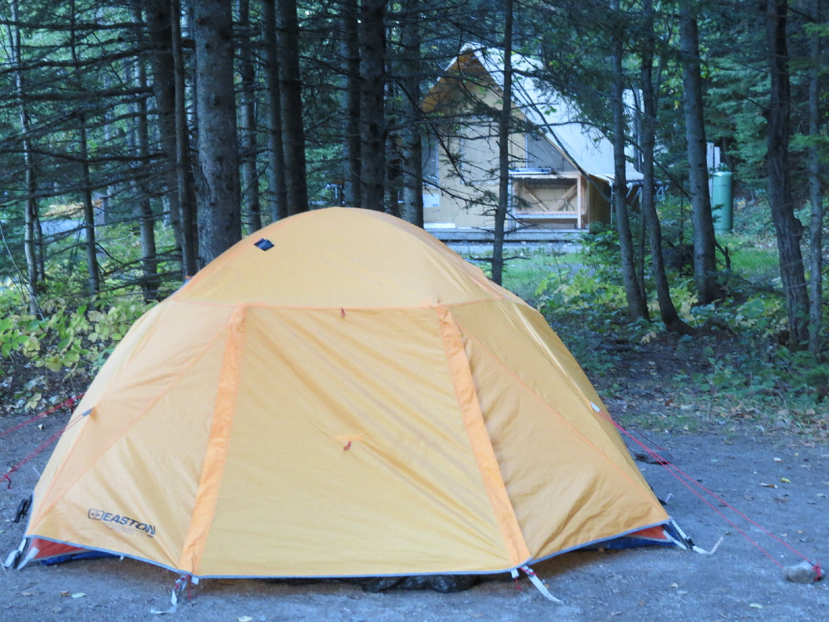 Tent perched at Parc National du Bic camping. Huttopia in background.