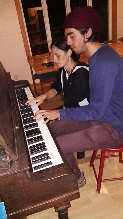 Playing the piano at the Auberge Internationale, Forillon National Park, QC,