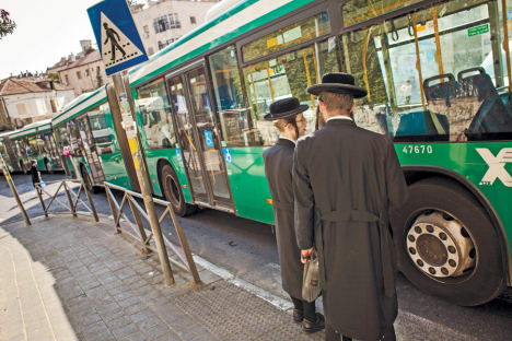 Haredi men at a Yafo street bus stop, Jerusalem