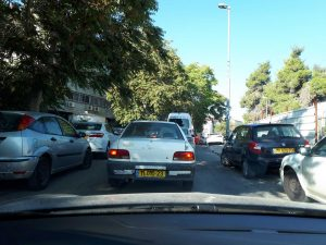Driving between parked Israeli cars - Perilously parking, perilously driving