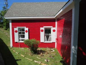 red house decorated with maple leaves, Campobello, NB