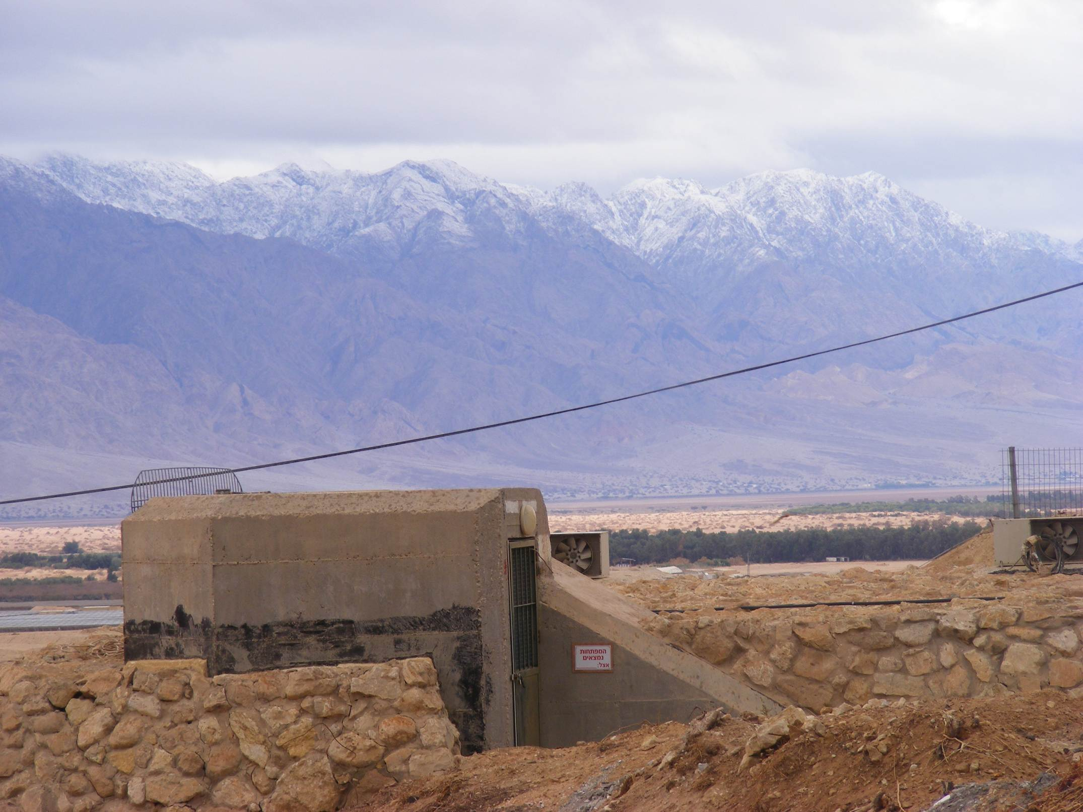 Kibbutz bunker against snowy Edom mountains, Arava 2013