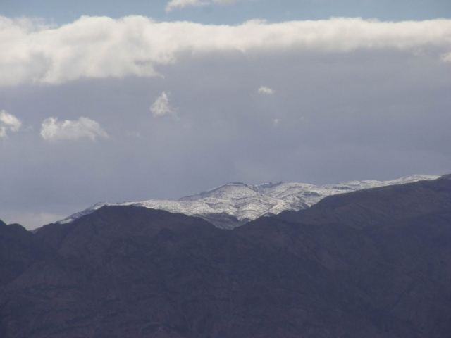Snowy peak peeking among Edom mountains, 2013