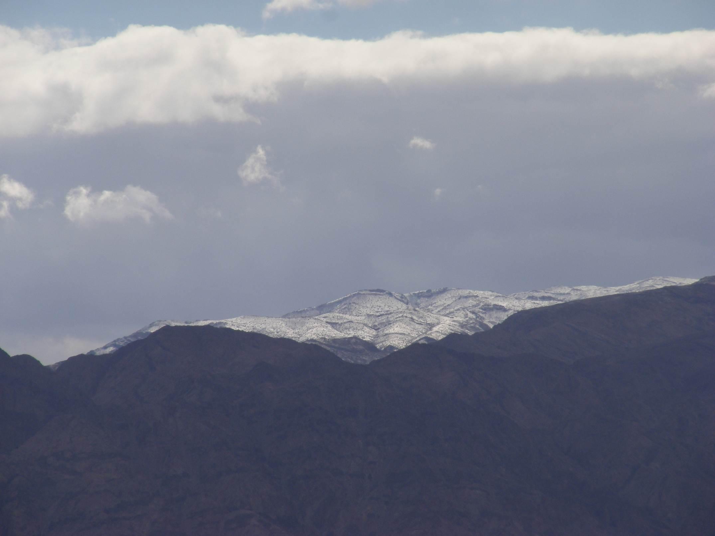 Snowy peak peeking among Edom mountains, 2013