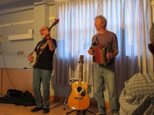 Newfoundland folk music. Jim Payne and Fergus O'Byrne playing accordion and banjo, Woody Point, NFL
