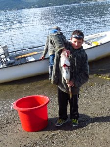 Fisbherman's son with catch, Woody Point, NFL