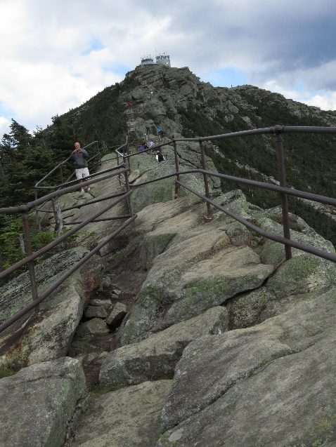 Rails help climbers on rocky part towards summti. Mount Whiteface. NYS