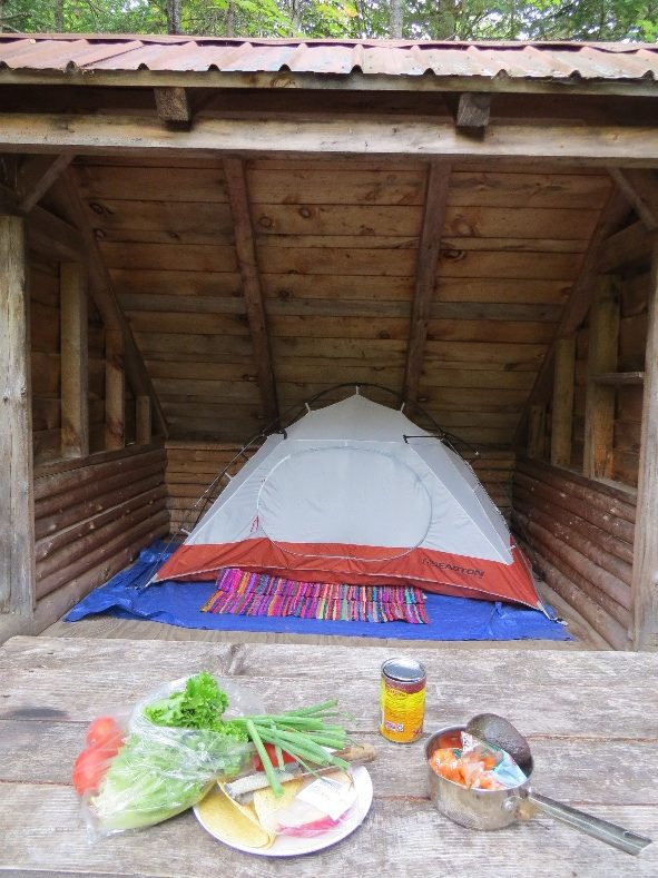 Tent perched in leanto at Draper's Acres private campground near Lake Placid, NYS