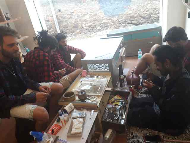 Israeli guys smoking at a silver shop in Pushkar, India