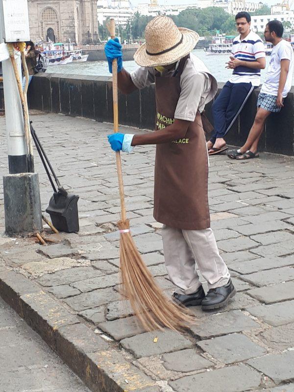Male street sweeper, Mumbai ocean promenade