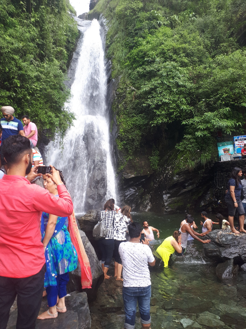 Pilgrims and vacationeers at Bhagsu Falls