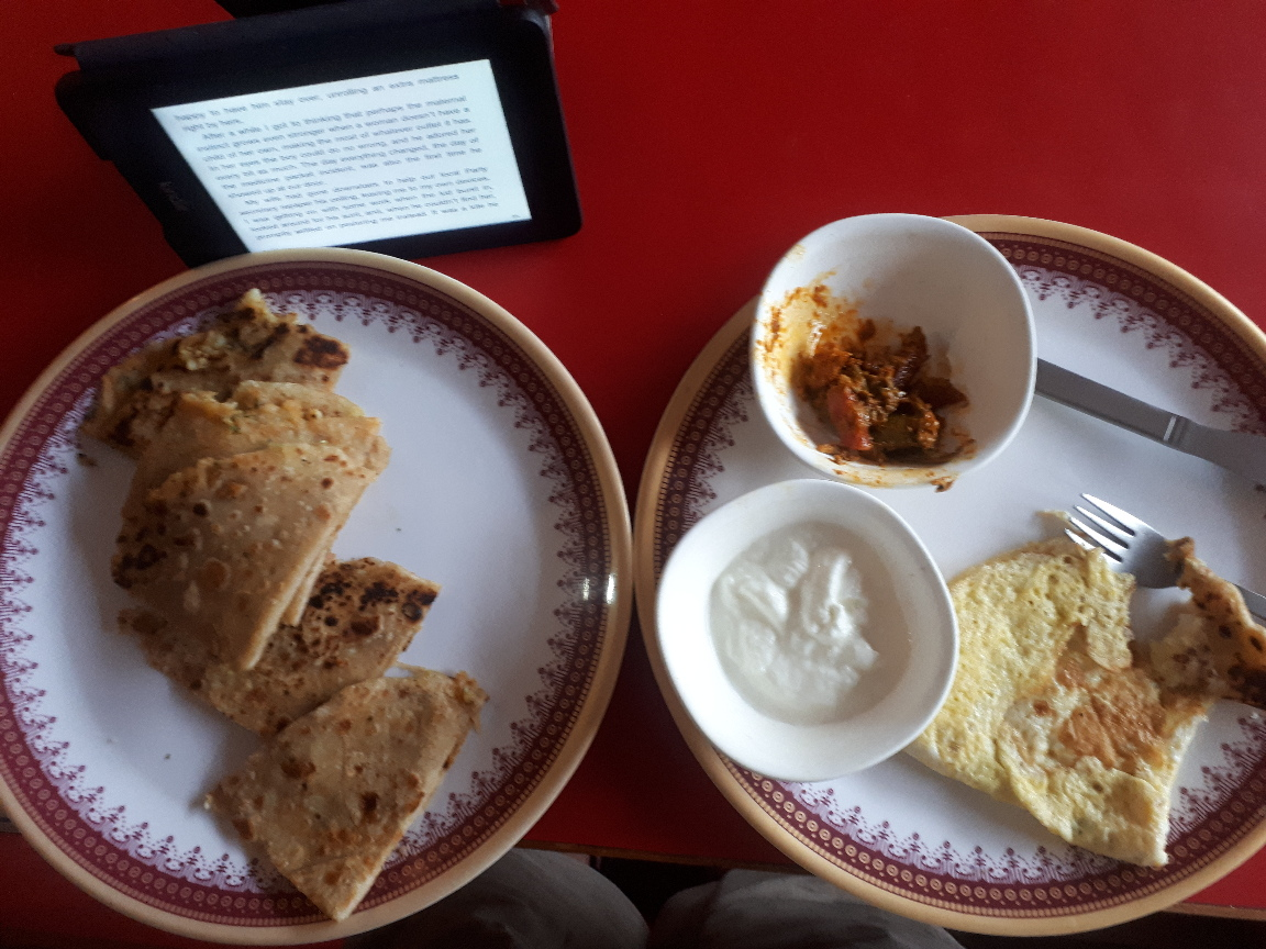 Breakfast parantha and omellete in a Bhagsu dhaba. Himachal Pradesh