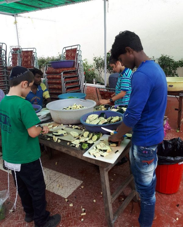 Children helping prepare Rosh hashana meal, Beit Chabad, Pushkar, Rajasthan, 2016