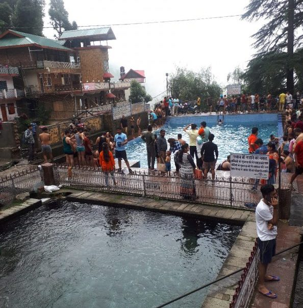Pilgrims bathe in pool by lower temple. Bhagsu, Himachal Pradesh