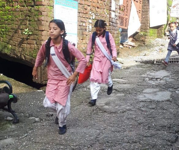 School started. Girls going to government school, Main Road Bhasgu, Himachal Pradesh