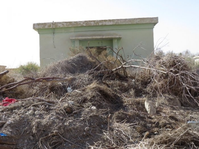 One more abandoned army building with dead vegetation. Kalya Beach