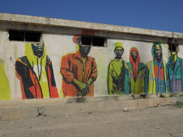 African figures. Mural. Old Jordanian Army Base. Kalia