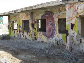 Libre, Mexican muralist. Israeli baby from Kalya. Gallery Minus 430.