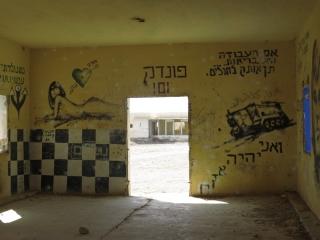 Soldiers graffiti on walls. Kalya Beach.