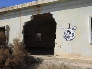 Old Jordanian army base with mural. Kalya Beach