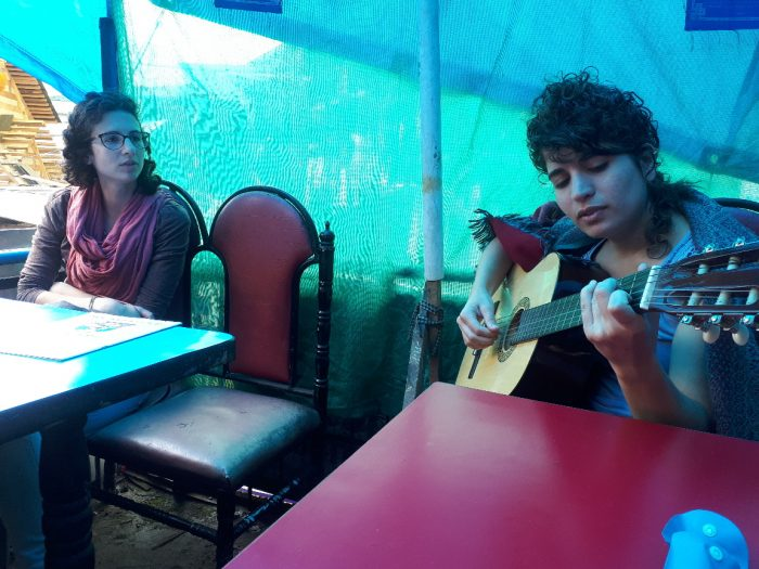 Israeli girls making music at Little Tibet cafe, Vashisht, Himachal Pradesh
