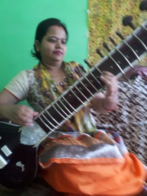 Nidhee, my singing teacher on her sitar. Bhagsu, Himachal Pradesh