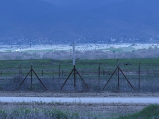 Border fences and the Jordanian side.