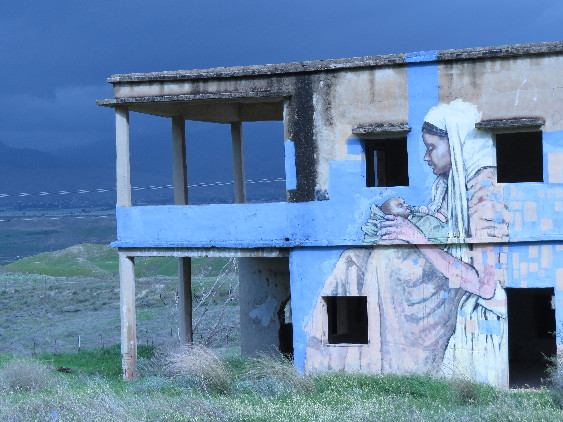 Mural art. Mother and child. Route 90 facing Jordan.